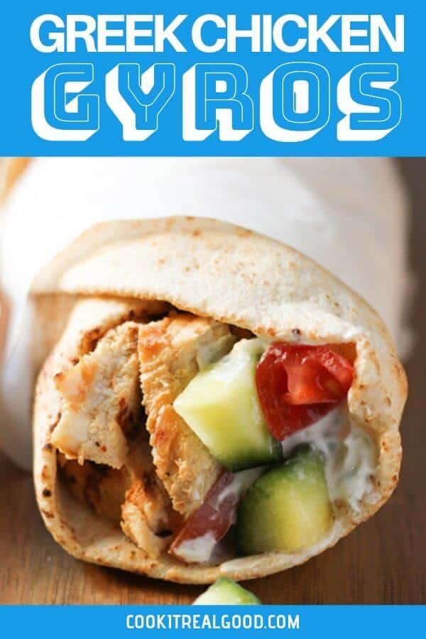 chicken gyros wrapped in parchment paper.