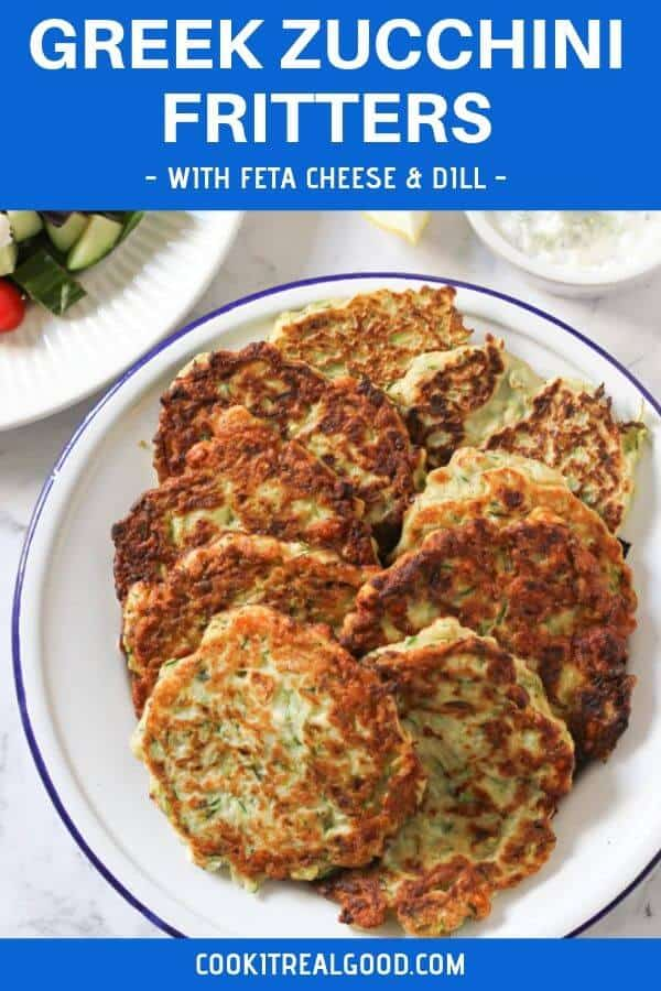 """zucchini fritters on a white plate with text overlay """"greek zucchini fritters with feta cheese and dill"""""""