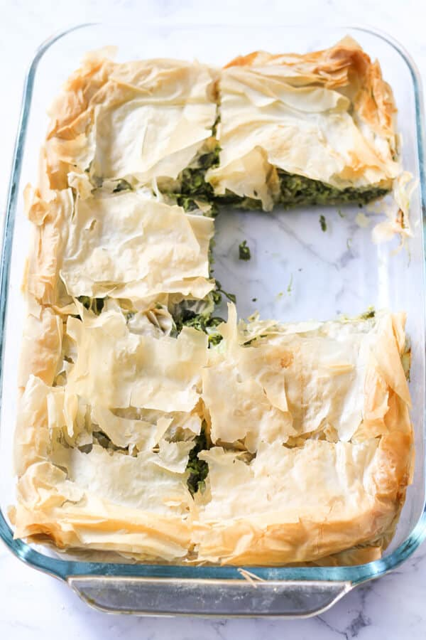 a tray of freshly baked spanakopita.