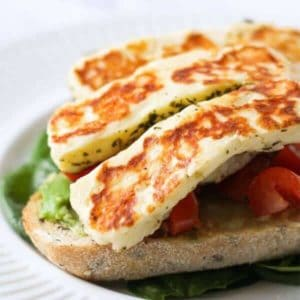 grilled halloumi on top of avocado toast.