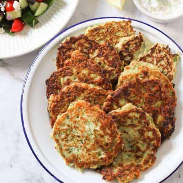 zucchini fritters on a white plate