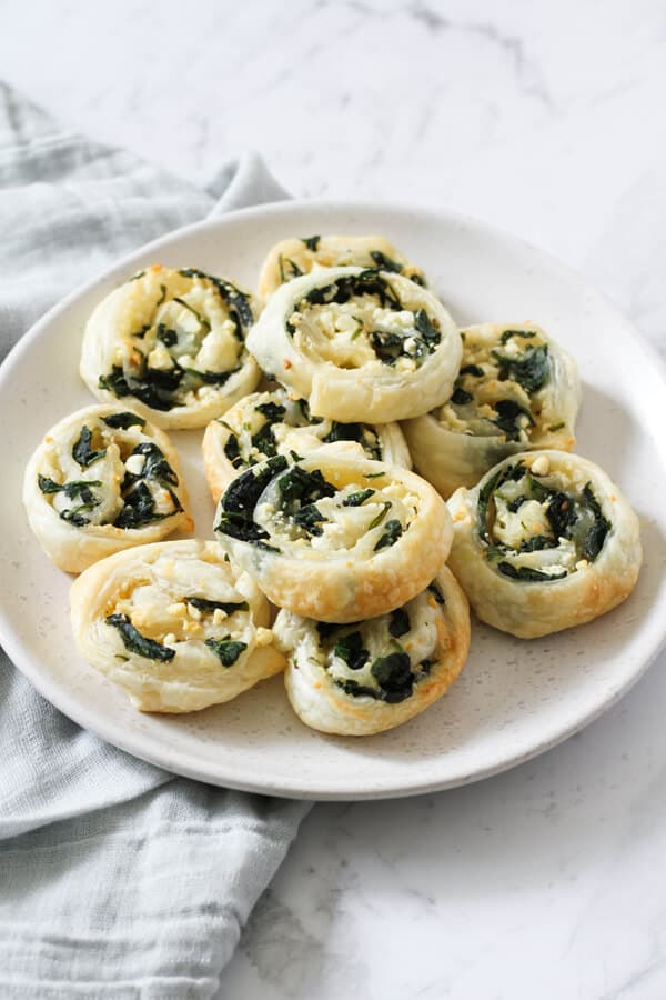 spinach & feta pinwheels on a white plate