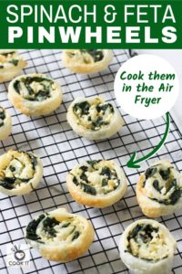 spinach and feta pinwheels on a wire rack.