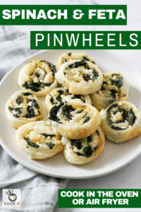 spinach and feta pinwheels on a white plate.