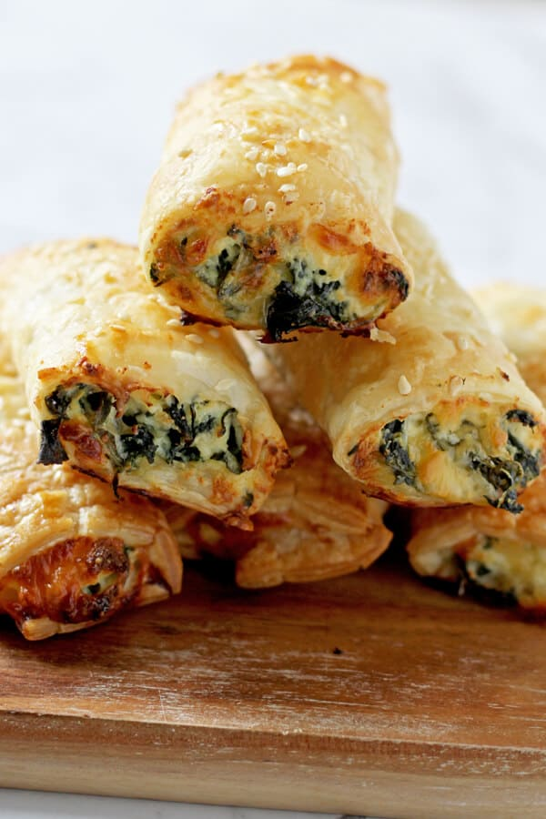 spinach and ricotta rolls stacked in a pyramid shape.