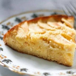 a slice of apple cake on a decorative plate.