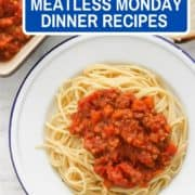 "lentil bolognese on a white plate with text overlay ""40 must-try meatless monday dinner recipes""."
