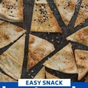 "pita chips on a baking tray with text overlay ""homemade baked pita chips""."