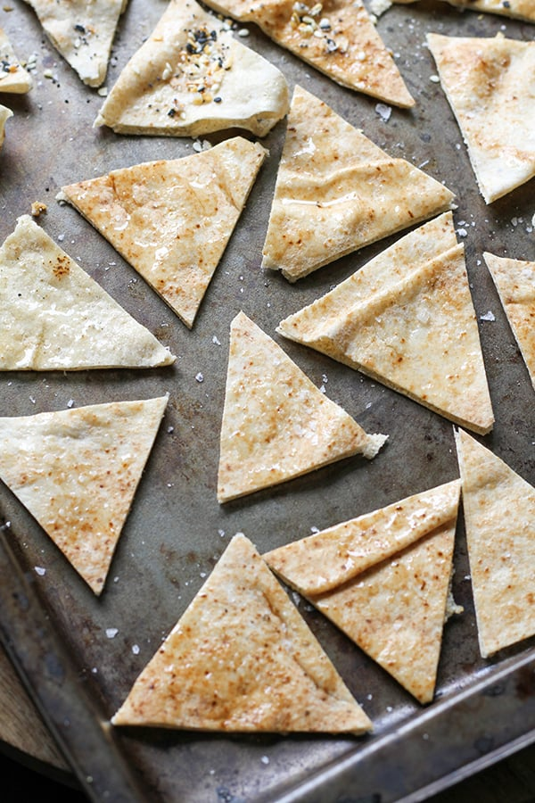 pita triangles on a baking tray ready to be baked.