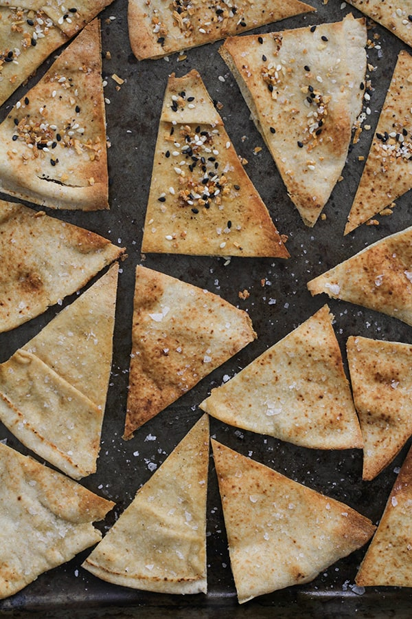 baked pita chips on a baking tray.