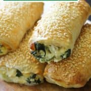 """spinach and ricotta rolls stacked on top of each other with text overlay """"spinach, feta & ricotta rolls""""."""