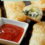 """spinach and ricotta rolls on a baking tray with text overlay """"spinach, feta and ricotta rolls""""."""