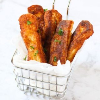 halloumi fries in a wire basket.