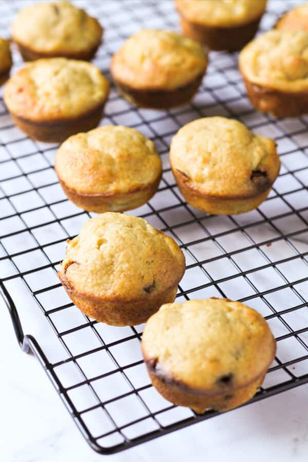 mini banana muffins sitting on a cooling rack.