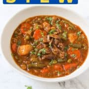 """stew in a white bowl with text overlay """"beef & vegetable stew""""."""