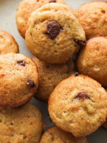 mini muffins stacked on a plate.