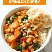 "curry on a bed of rice with text overlay ""sweet potato, chickpea & spinach curry""."