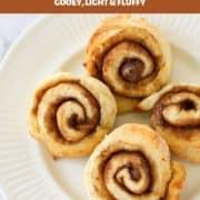 cinnamon scrolls on a white plate.