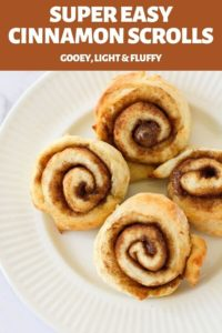 cinnamon scrolls on a white plate.