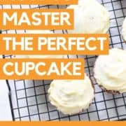 "cupcakes on a wire rack with text overlay ""how to master the perfect cupcake""."