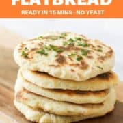 "yoghurt flatbreads stacked on top of each other on a wooden board with text overlay ""quick & east flatbread"""