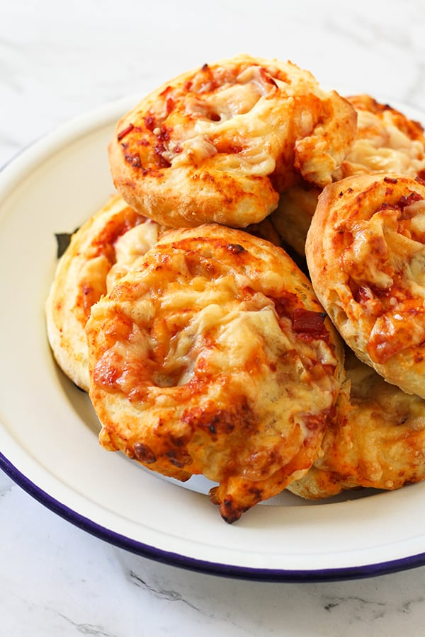 ham and cheese scrolls on a white plate.