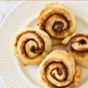 cinnamon rolls on a white plate.