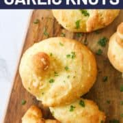 garlic knot on a wooden board.