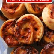 """pizza scrolls piled up in a plastic container with text overlay """"pizza scrolls with 2 ingredient dough""""."""