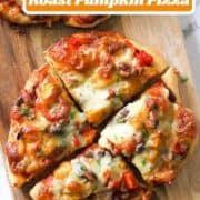 "pizza on a wooden board with text overlay ""fall favorite roast pumpkin pizza""."