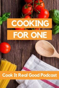 """Ingredients laid out on top of a stained wooden background with text overlay """"cooking for one""""."""