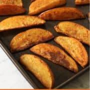 Crispy Baked Potato Wedges on a baking tray.