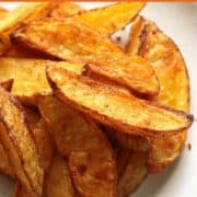 Crispy Baked Potato Wedges on a white play.