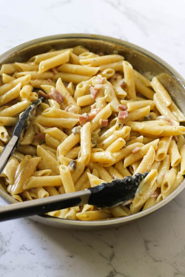 Creamy Carbonara in a frying pan.