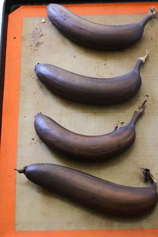 Roasted bananas on a baking tray.
