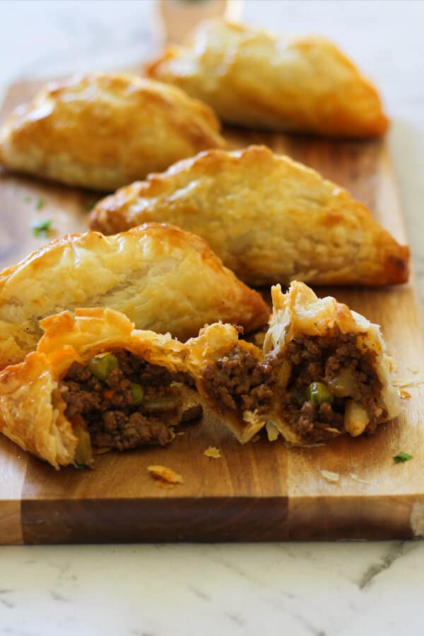 Beef Pasties on a wooden board.
