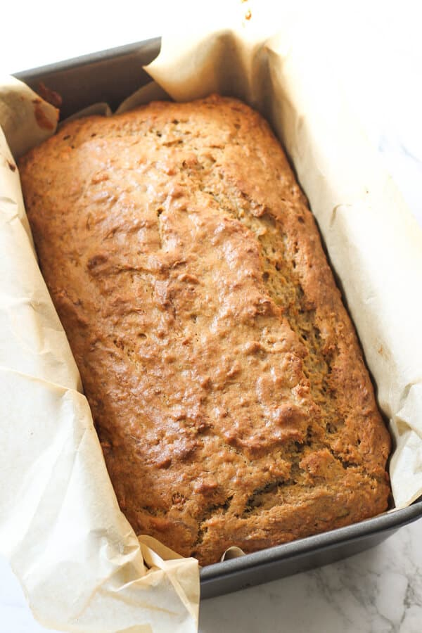 banana bread in a loaf pan straight out of the oven.