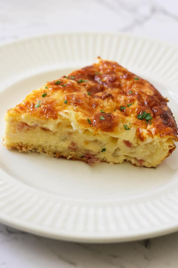 a slice of Impossible Quiche on a white plate.