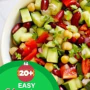 """Middle eastern bean salad in a white bowl with text overlay """"20+ easy Christmas salad recipes""""."""