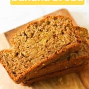 "slices of banana bread stacked on top of each other on a wooden board with text overlay ""buttermilk banana bread""."