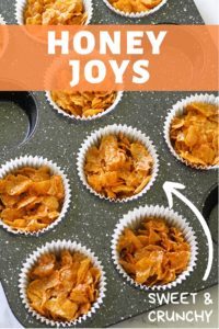 Honey joys in white paper liners in a muffin tin.
