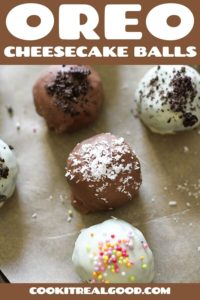 oreo balls laying on baking tray covered in cookie crumbs and sprinkles.