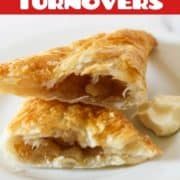 apple turnover broken into halves on a white plate.