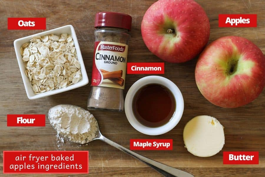 ingredients for air fryer baked apples on a wooden board.