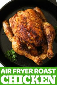 """Whole roast chicken sitting in air fryer basket with text overlay """"air fryer whole chicken""""."""