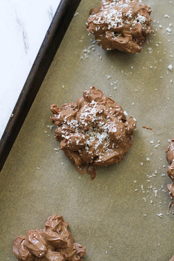 close up of a chocolate almond cluster on a baking tray