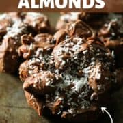 chocolate covered almonds on a rusted baking dish.