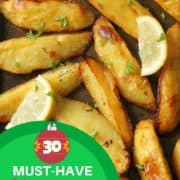 "roasted lemon potatoes on a white plate with text overlay ""30 must-have christmas side dishes""."