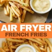 "French fries on a grey plate with a bowl of aioli with text overlay ""air fryer french fries""."