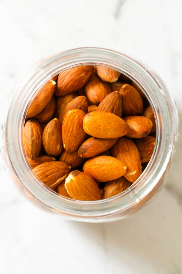 roasted almonds in a glass jar.